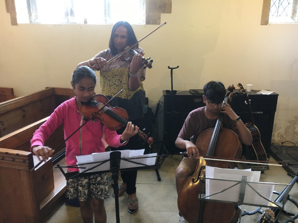 Aakash and shirvai playing at family service - journal 2017