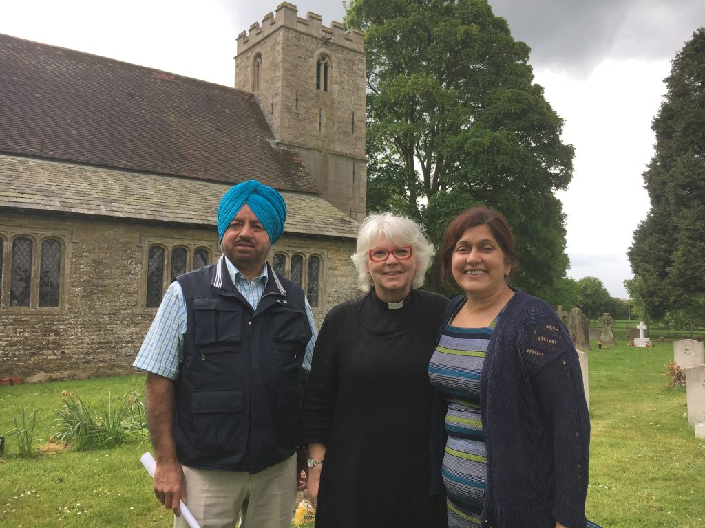 Revd. Sue Deacon with the chief exec. of West Lindsey District Council, Manjeet Gill and her husband Kuldip at the Commonwealth War Graves during the churches festival.