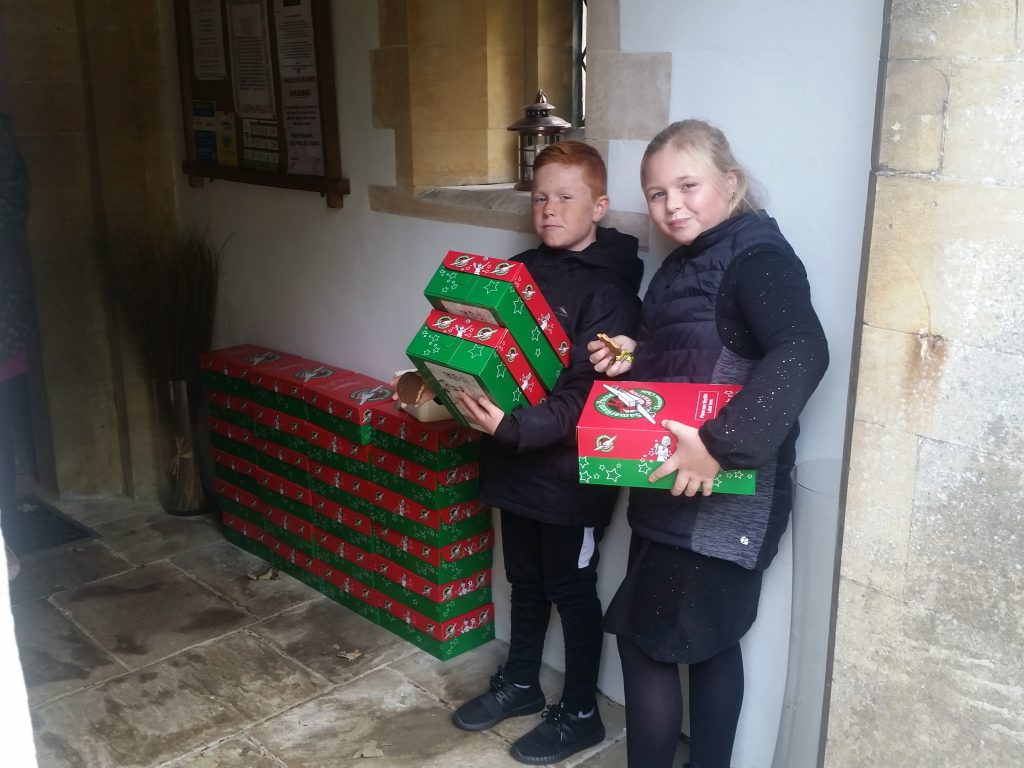 Operation Christmas Child shoeboxes are given out.