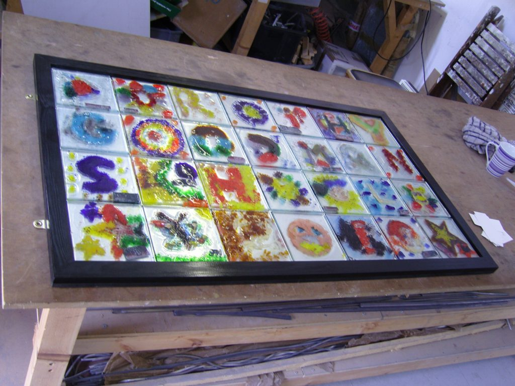 Here is an example of a collage of glazed tiles created by children at another school. Similar collages of tiles created by the children at our local Primary Schools will be displayed in church and at the schools.